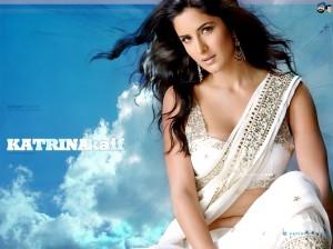 Wearing a nice white sari,